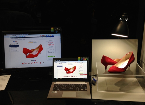 Technicolor's ecommerce Color Certification demo at CES 2013. The color certified laptop in the middle of the frame more accurately shows the color of the shoes.